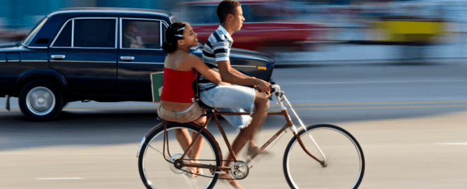 cuban riding on a bike with a girl on the back