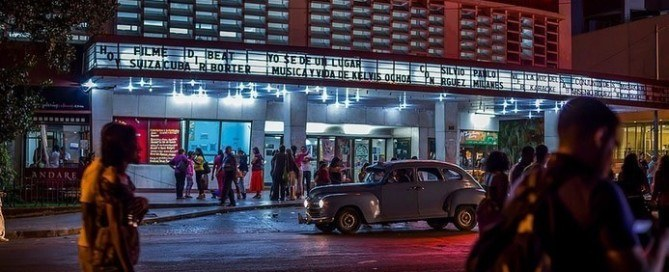 La-Rampa,Havana, in front of the Cinema Yara with old car and cuban girls