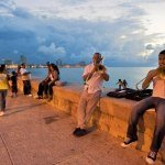 Men playing music and a party on Malecon Havana, Cuba