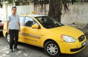 Cuban State taxi driver.