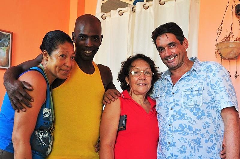 Gustavo (on the right) with Cuban friends and family.